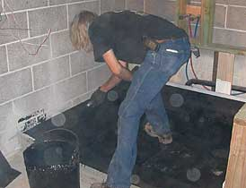 and as easy as 1 2 3 itu0027s hot mopped the tile goes on over this we actually did not originally plan for tile here but we didnu0027t know we had to do